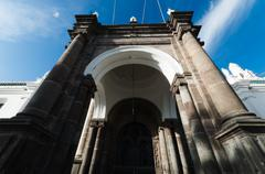 Historical archway and main door of city cathedral in Quito Stock Photos