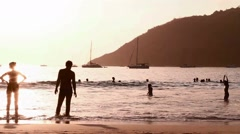 magical sunset lighting couple at beach - stock footage