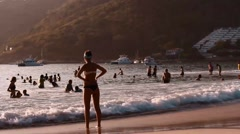 Young caucasion woman hands on hips at ocean Stock Footage