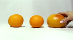 Two oranges and grapefruit. Not like everyone else. - stock footage