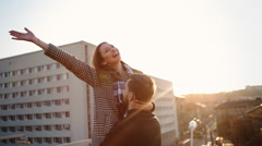 Happy handsome man holding his girlfriend on hands, outdoor Stock Footage