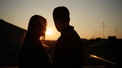 Couple staying on the balcony and spending calm evening together Stock Footage