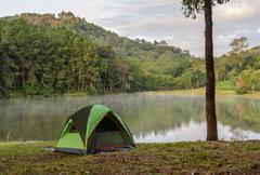 Camping tents near lake at Pang Oung in Mae Hong Son, Thailand - stock photo