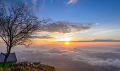 Majestic sunrise with sea of fog - stock photo