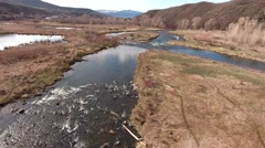 A beautiful aerial shot of a flowing river in nature reserve Stock Footage
