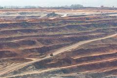 Mining dump trucks working in Lignite coalmine lampang thailand - stock photo