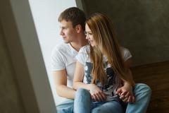 Romantic happy young couple relax at modern home indoors Stock Photos