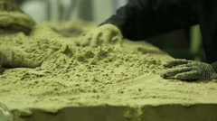 Preparing sand mold for casting - stock footage