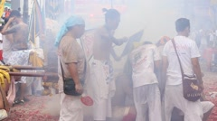 Smoke and explosions firecrackers in Vegetarian Festival, Phuket Town. Thailand Stock Footage