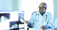 Doctor And Woman Patient. Explaining X-Ray, Mammography Stock Footage