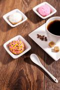 Cup of coffee  and marshmallow biscuits with icing colored granules on white Stock Photos