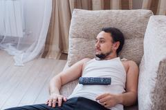 Sunday afternoon lying on the couch - stock photo