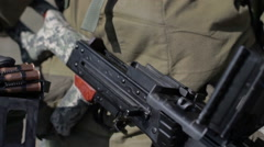 A soldier with a machine gun at a military training ground during the day Stock Footage