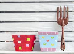 flowerpots and old gardening fork - stock photo