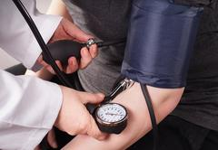 Blood pressure check up - stock photo