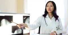 Asian female doctor, x-ray, hospital Stock Footage