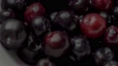Wet thawed blueberries added to pancake batter then folded into cake mixture  Stock Footage