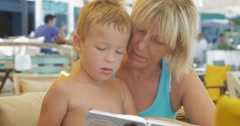 Child with grandmother and book - stock footage