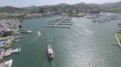 Boat heading towards harbor - St Lucia Stock Footage