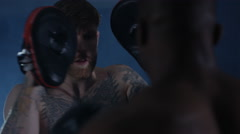 4K MMA fighter training with partner in dark environment - stock footage