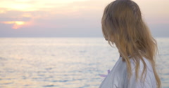 Woman with pink awareness ribbon by the sea - stock footage