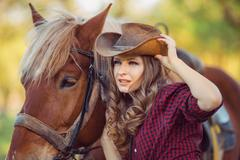 Horse and fashion model with cowboy hat - stock photo