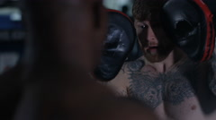 4K MMA fighter training with partner in dark environment Stock Footage