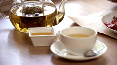 Hot greeen tea in the teaspot. Close up. Slow motion Stock Footage