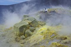 Geologists taking minerals samples on Gran Cratere (The Great Crater), Vulcano Stock Photos