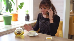 Beautiful woman waiting for man and drinking tea. Slow motion Stock Footage