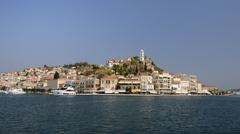 Poros town and harbour viewed from the sea, Poros island, Attica, Peloponnese, - stock photo