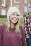 Two girls outdoors in woolly hats in autumn. Stock Photos