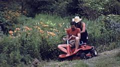USA 1982: man cutting grass in the garden Stock Footage