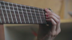 woman's hands playing  acoustic guitar, close up - stock footage