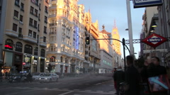 Timelapse of People and vehicles crossing the Gran Via street in Madrid, Spain Stock Footage