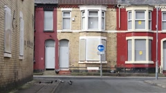 A street of boarded up derelict houses awaiting regeneration in Liverpool UK Stock Footage