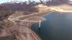 High aerial shot of a mountain reservoir and dam Stock Footage