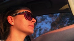Drive. Close up of young woman driving during sunset time. Stock Footage