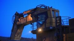 Mining dump truck loading by wheel loader. Excavator bucket Stock Footage