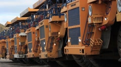 Coal mining : big truck loaders leaving one by one Stock Footage