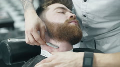 Barber shaving man with vintage razor - stock footage