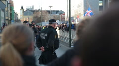 Police at Icelandic Parliament watching protesters Stock Footage