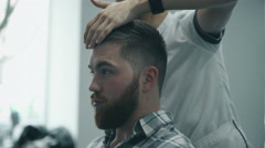 Hairdresser combing hair - stock footage