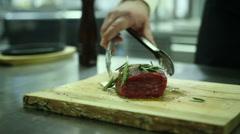 Chef sprinkles spice steak - stock footage