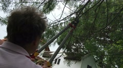 Older retired man cutting branches in outdoor activity. Stock Footage