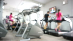 Fitness activity blurred in the gym. Sport men and women - stock footage