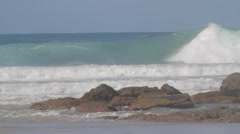Pro Surfers paddling out to at Snapper Rock during Cyclone Winston swell Stock Footage