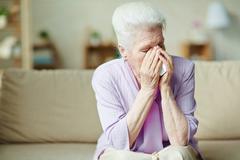Despaired senior woman - stock photo