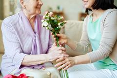 Giving bunch of fresh roses Stock Photos