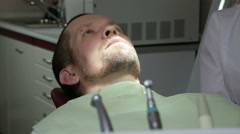 Close up of man having his dental treatment Stock Footage
